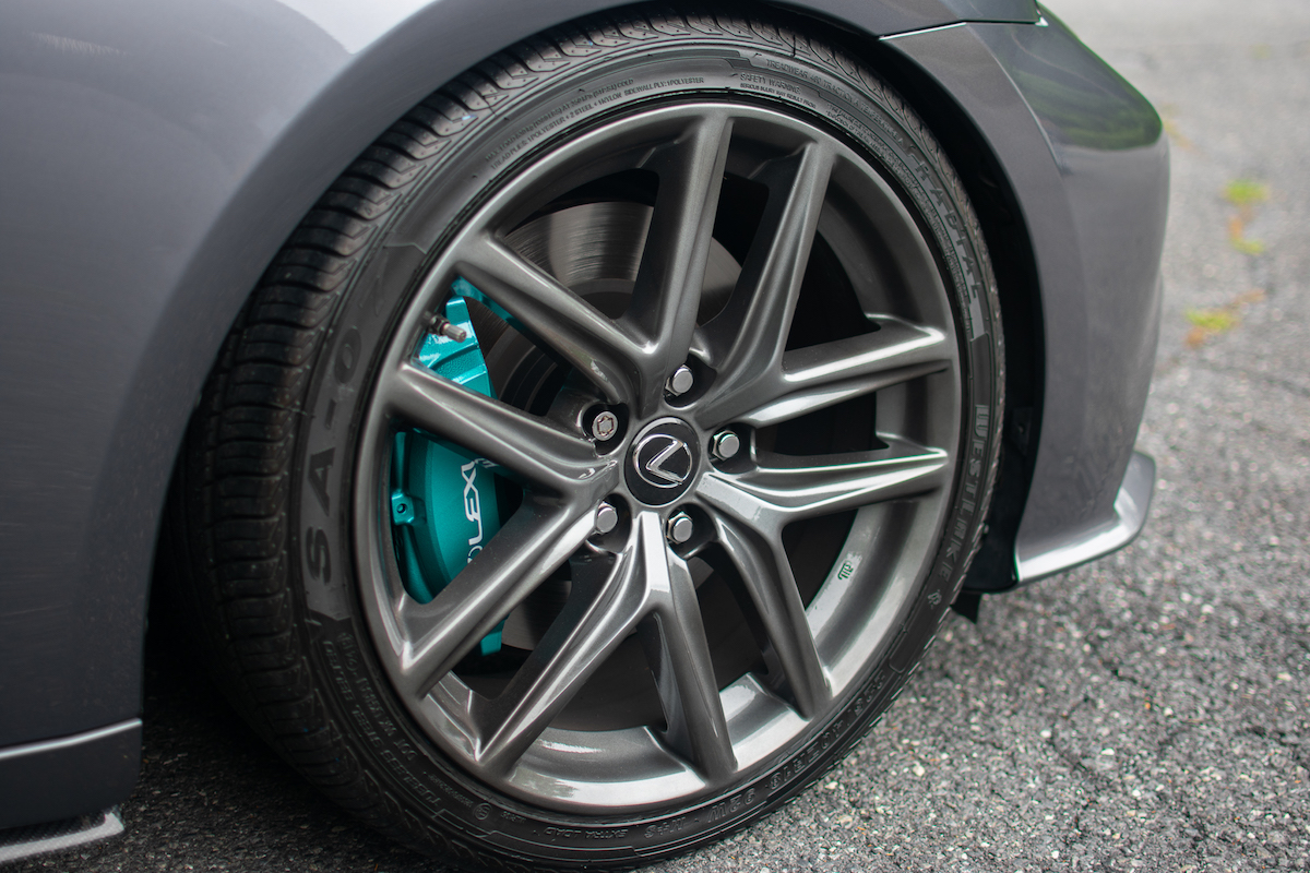 Close Up Of Custom Painted Brake Calipers On A Lexus.